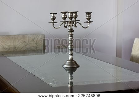 Silver Antique Candlestick On The Table In A Bright Interior