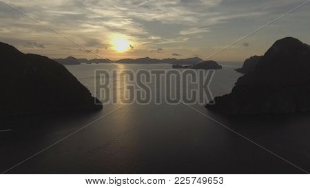 Tropical Bay In El Nido Sunset. Aerial View: Tropical Landscape. Sunset Sky And Mountains Rocks Of B