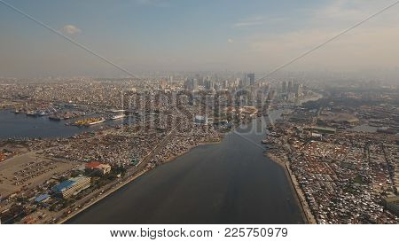 Aerial View Skyline Of Manila City. Fly Over City With Skyscrapers And Buildings. Aerial Skyline Of