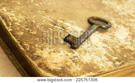 Key Lying On An Old Book - Solution, Wisdom Concept