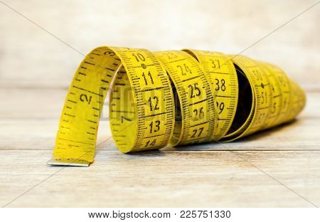 Numbers Concept - Retro Yellow Tape Measure Close-up
