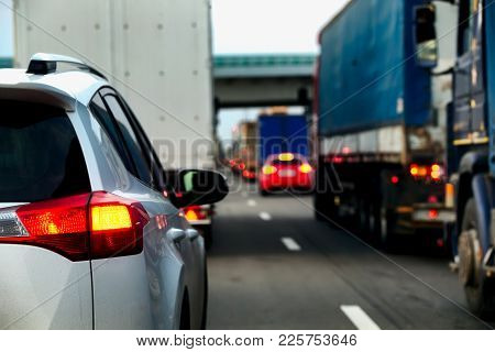 Intense Traffic Flow Of Trucks And Cars. Jam On The Highway. Road Repair Works. Rear View.