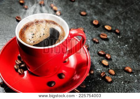 Cup Of Fresh Coffee With Coffee Beans On Stone Table