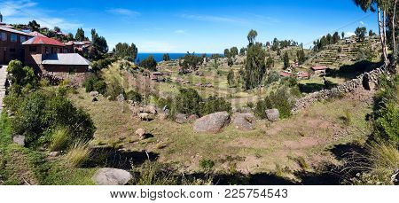View Of Titicaca Lake And Taquile Island With Traditional Houses And Terrace Fields, Peru