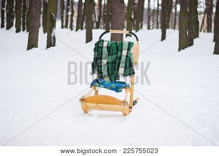 Tree Harnesses In The Snow With A Green Blanket