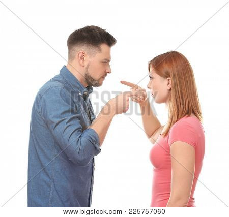 Displeased couple during quarrel on white background