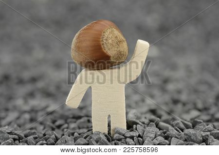 Wooden Male With Hazelnut Instead Of Head