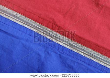 Texture Of The Surface Of Blue And Red Fabrics With A Zippered Diagonal Lock
