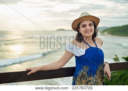 One Hispanic Woman On Sunset Background. Happy Smiling Latina Girl