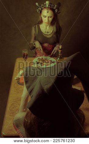 Gothic Horned Girl  Having Dinner Over Dark Background