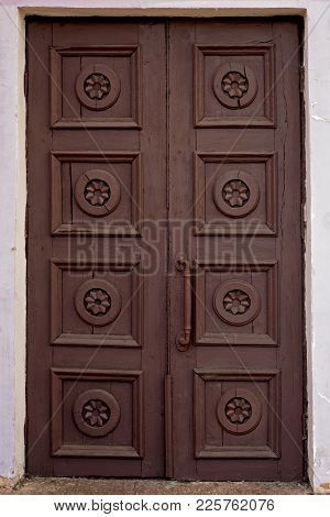 Old Brown House Door. Wooden Vintage Building Gate Weathered. Closed Ancient Doorway Exterior.