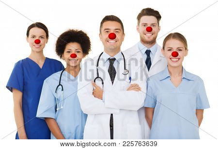 medicine, red nose day and healthcare concept - international group of smiling doctors and nurses with stethoscopes over white background