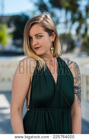 Sleeveless Blue Evening Gown Worn By Alternative Model Descending Stairway.  Shot In Ventura On Febr