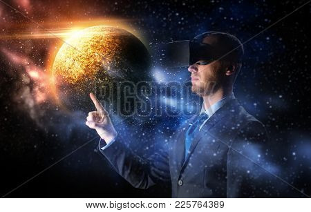 3d technology, virtual reality, cyberspace and augmented reality concept - young businessman with virtual reality headset or 3d glasses over planet and space background