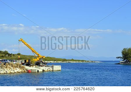 Antipaxos Harbour, Greece - October 01, 2017 : A Mobile Crane On Antipaxos A Small Island South Of C