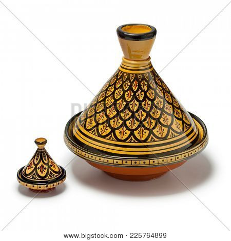 Moroccan handmade decorated large and small tagine isolated  on white background