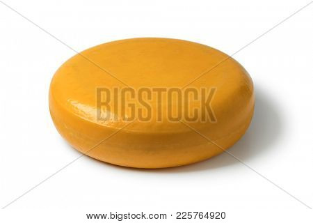Whole round yellow Gouda cheese isolated on white background