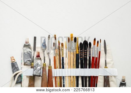 Paintbrushes, Palette Knifes And Paint Tubes In Textile Carry Bag. A Storage Case Filled Of Tools Fo