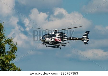 Vordingborg Denmark - June 26. 2016: Danish Tv2 News Helicopter In The Air Filming