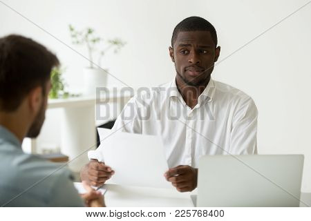 African American Hr Manager Looking Doubtful About Hiring Incompetent Candidate, Uncertain Distrustf