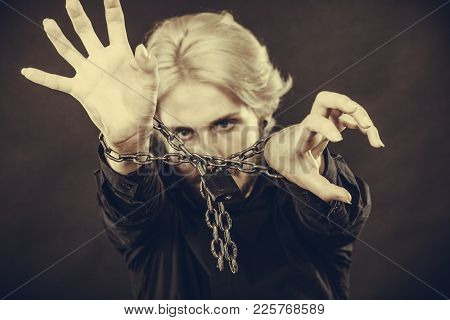 No Freedom, Social Problems Concept. Furious Man With Chained Hands, Studio Shot On Dark Grunge Back