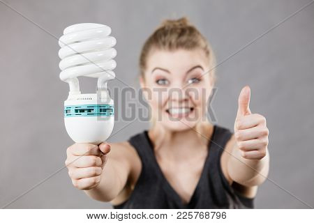 Happy Woman Holding Eco Modern Light Bulb. Innovation Technology, Power Saving Concept.