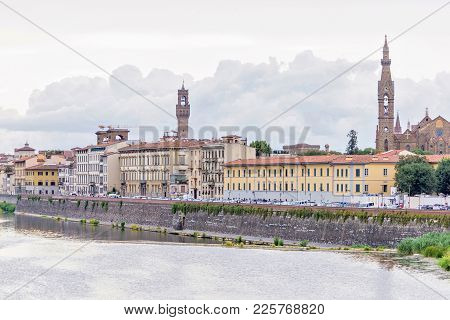 Daylight Cloudy Day View To Arno River With Reflections
