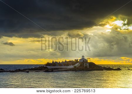 Agios Fokas Near Monemvasia In Stormy Weather, Dark Clouds Overcast Sky, Sunrise. Small Cemetery On