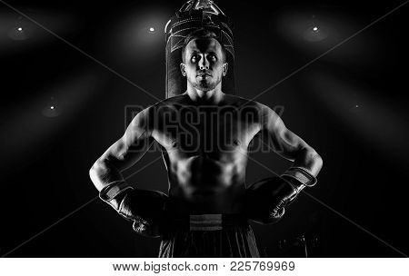 Professional Sportsman Of Mixed Martial Arts Stands After The Fight Won Near The Bag