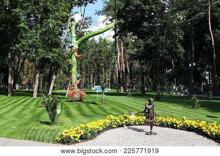 Kharkov, Ukraine - September 5, 2017: There Are Art Installations (tree Of Abandoned Things And Girl