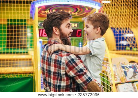 Cute little boy having fun with his dad at the entertainment centre