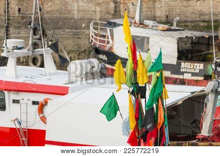 Closeup Of Flags Hung On Floats On Fishing Boats