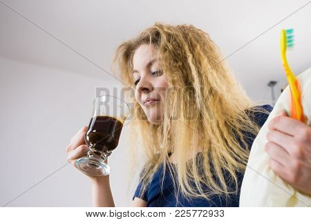 Funny Woman Holding Black Coffee And Toothbrush Being Late. Getting Morning Energy, Hurry Up Before