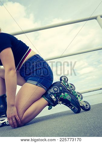 Unrecognizable Woman Putting On Roller Skates. Female Being Sporty Having Fun During Summer In City