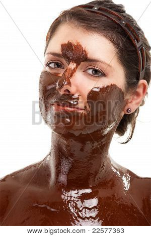 young woman having a chocolate face mask