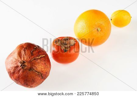 Fresh Fruits Lemon Orange Persimmon Pomegranate Isolated On White Background With Copy Space, Close-