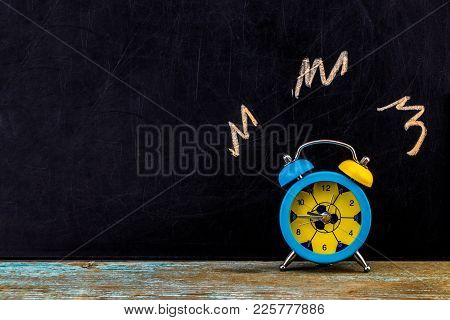 Ringing Alarm Clock On Dark Background, Suggesting Wake-up Time Or Deadline.with Copy Space