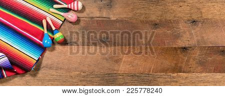 Cinco De Mayo Background Image On With Maracas And Serape On Wooden Rustic Boards