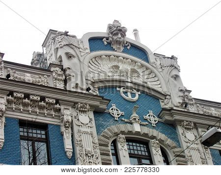 Beautiful Art Nouveau Building With Blue Facade And Human Faces In Riga, Latvia