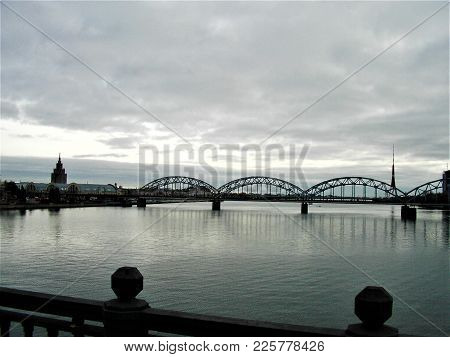 View Over Daugava River With Bridge, Skyline And Spire In Riga, Latvia
