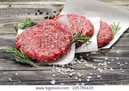 Billets For Burgers From Fresh Minced Meat With Spices On A Wooden Table.