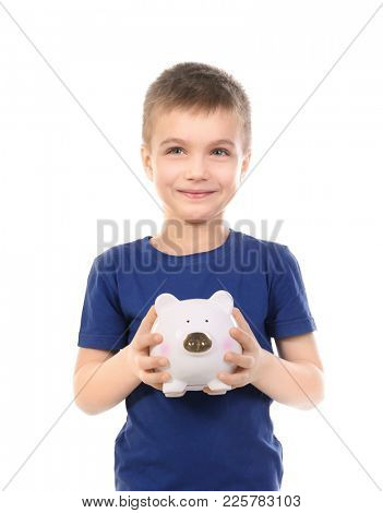 Cute boy holding piggy bank on white background