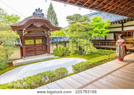 Kyoto, Japan - April 28, 2017: Illustrative Editorial Of Woman In Geisha Makeup Looking Zen Garden I