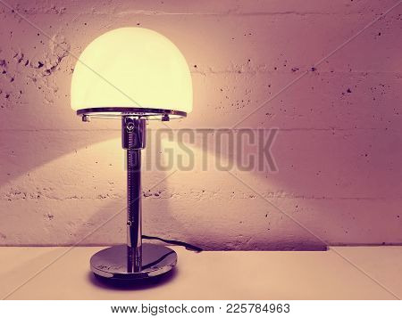 Lamp With Round Lampshade Near Concrete Wall. Contemporary Design.