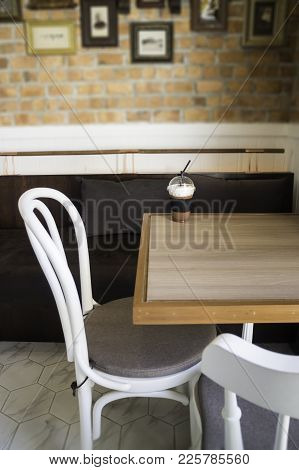 Iced Milk Froth Coffee Serving On Wooden Table, Stock Photo