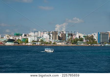 City Male On The Same Island Of The Atoll Kaafu, The Capital Of The Maldives, In The Foreground A Sm