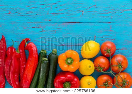 Still Life Of Assorted Fresh Healthy Vegetables And Ripe Lemons With Red Hot Cayenne Chili Peppers,