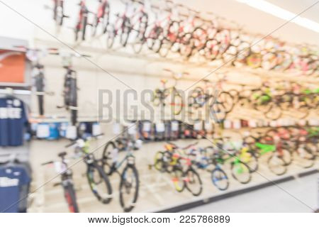 Blurred Three Tier Sloping Display Rack Bicycles At Sporting Goods Chain In America