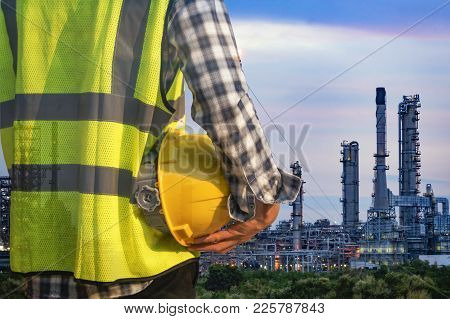 Engineer Standing At Oil Refinery, Power And Energy Crisis Concept