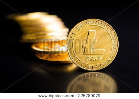 Litecoins. Digital cryptocurrency. Altcoins on black table.